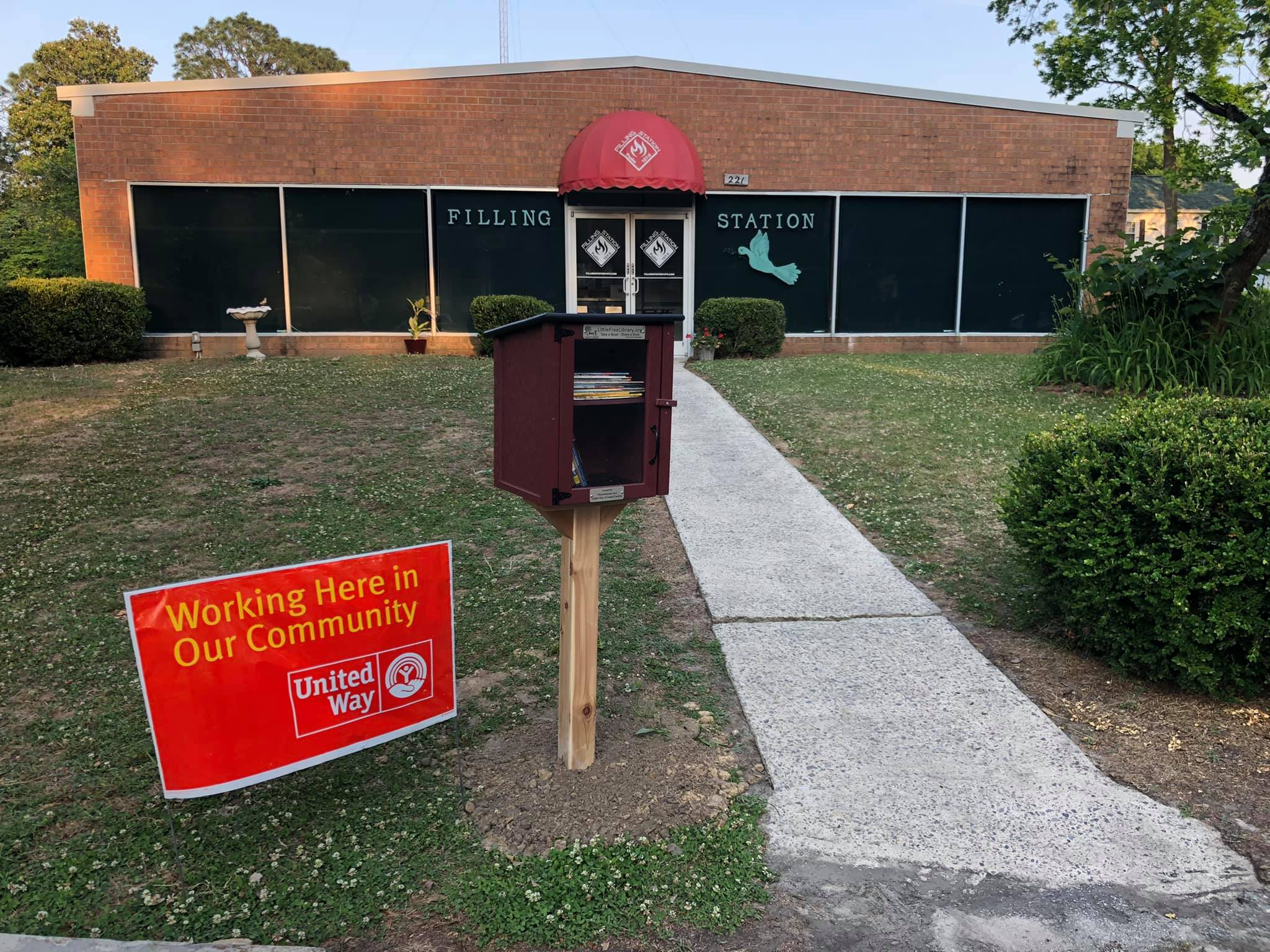Installation of the Little Library at the Filling Station in Pollocksville, NC